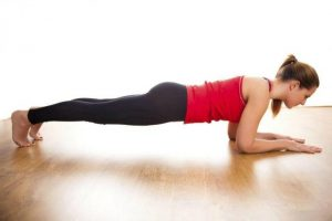 Woman in planking position to gain strength