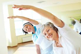 Happy senior woman doing exercises