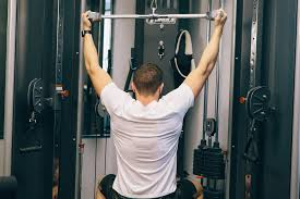 Man doing exercises with equipment back strength