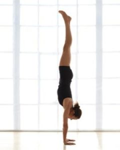 Woman doing handstand yoga position
